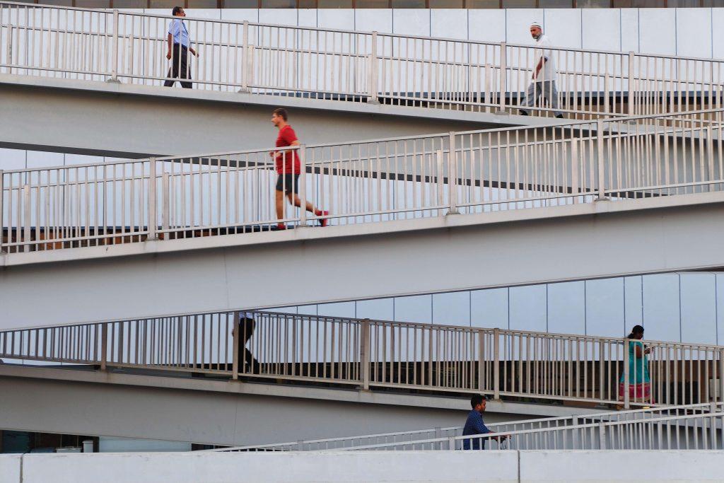 Man walking down a ramp